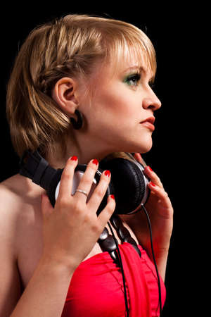 immersed: young blonde girl listening to music