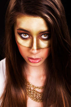 light complexion: attractive young woman with a golden mask