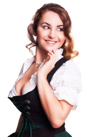 tracht: beautiful woman in a traditional bavarian dirndl isolated on white Stock Photo