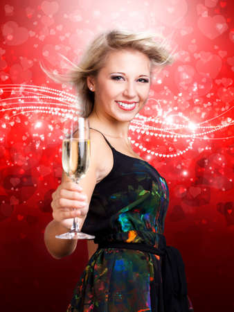 ravishing: young woman with sparkling wine in front of a club background Stock Photo
