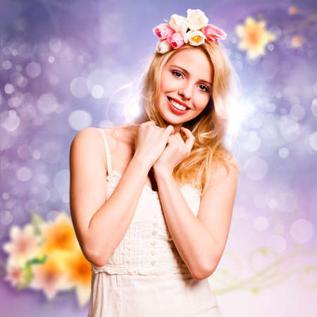 beautiful background: beautiful blonde woman with tulip hair decoration in front of a spring scene