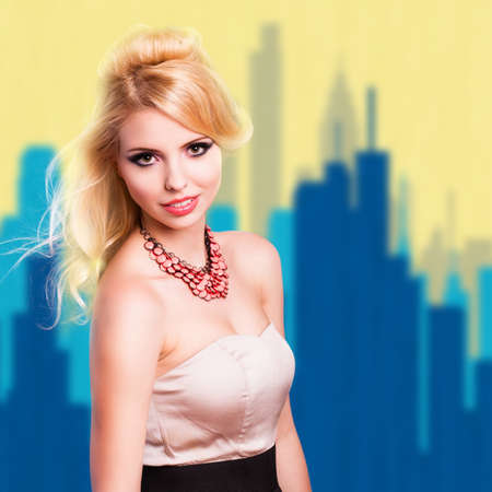 eveningwear: attractive woman in evening wear in front of a painted cityscape