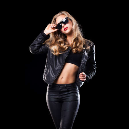 glam rock: attractive young blonde dancing girl in party clothes