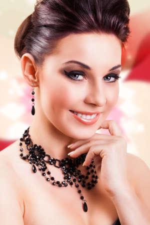 dark haired: attractive smiling woman with glamorous look