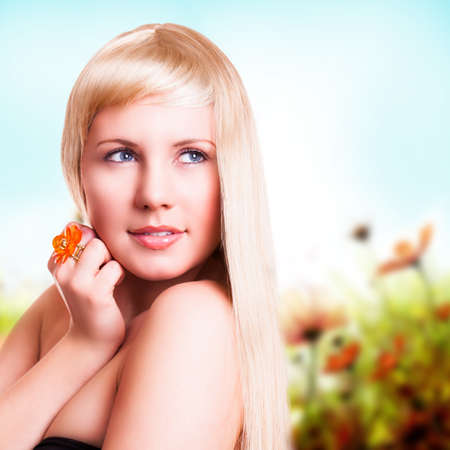 attractive charismatic: attractive blond woman in front of spring background Stock Photo