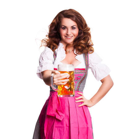 dirndl dress: beautiful woman in a traditional bavarian dirndl with a beer Stock Photo