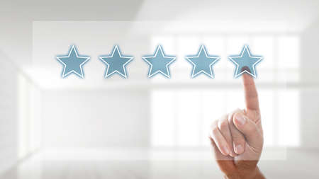 five star: giving a five star rating Stock Photo
