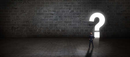 businessman standing in front of a portal shaped as a questionmark 스톡 콘텐츠