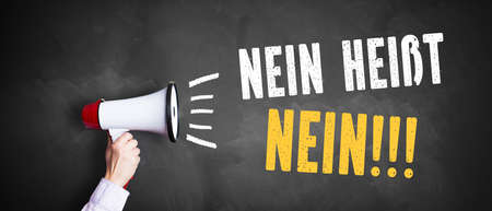 abuser: megaphone with No means No!!! (in German) on a chalkboard Stock Photo