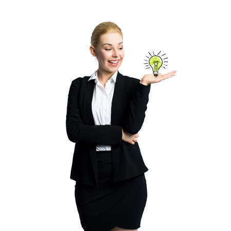 envisage: attractive businesswoman having an idea Stock Photo