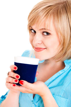 energising: smiling blond woman with a cup isolated on white Stock Photo