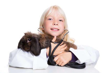 heart sounds: young girl dressed as a veterinary holding a bunny Stock Photo