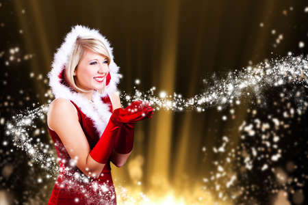 attractive smiling miss santa with christmas magic