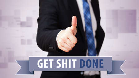easy going: businessman shows thumb up to phrase Get shit done!