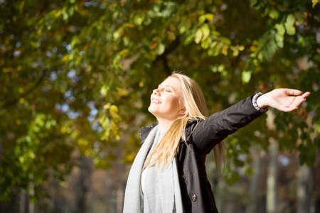 attractive woman enjoying autumn sun