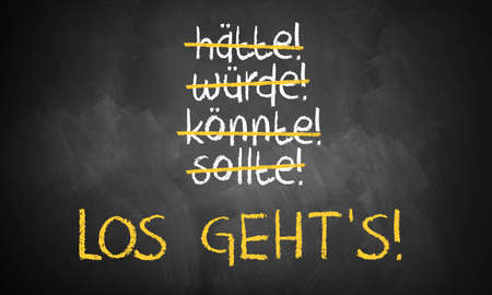 exclamatory: chalkboard with stroked words like could and should and Lets go in the middle in German