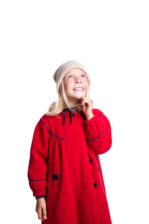 girl looking up: adorable girl in winter clothes looking up on isolated background