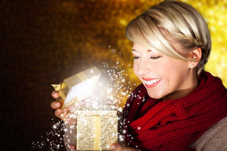 attractive woman opening a gift