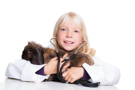 heart sounds: young girl dressed like a vet with a bunny Stock Photo