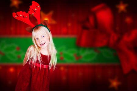 antlers: little girl with reindeer antlers Stock Photo