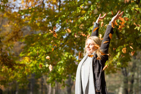 attractive blonde woman enjoying the autumn sun