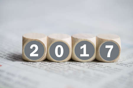 year financial statements: cubes with 2017 on it on a newspaper