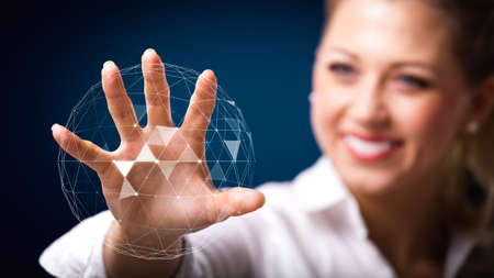 corporate office: businesswoman touching a holographic globe