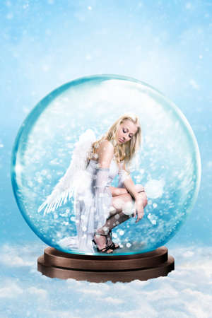 trapped: blonde angel trapped in a snowglobe Stock Photo