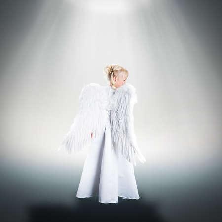 religious clothing: little girl dressed like an angel