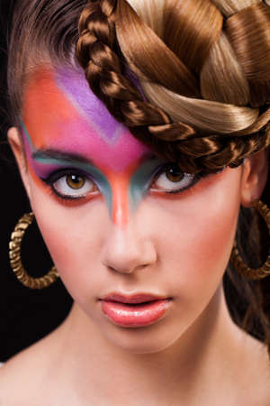 smile face: attractive young woman with colorful make-up Stock Photo