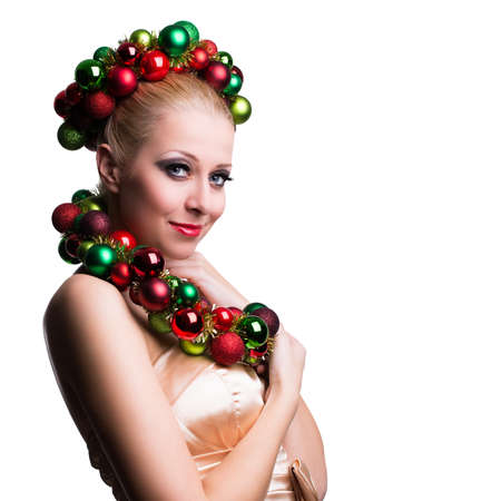 attractive woman with a christmas hair decoration isolated on white