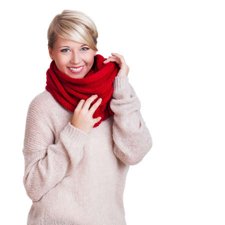 mature woman: young woman cuddling in her pullover Stock Photo