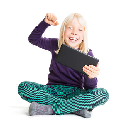 young girl with a tablet isolated on white Stock Photo