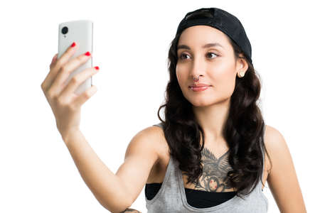 capture the moment: young woman taking a selfie, isolated on white