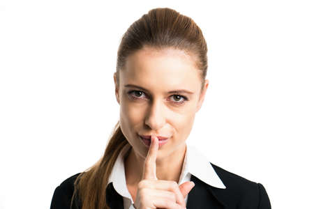 undetermined: businesswoman with secretive gesture isolated on white background Stock Photo