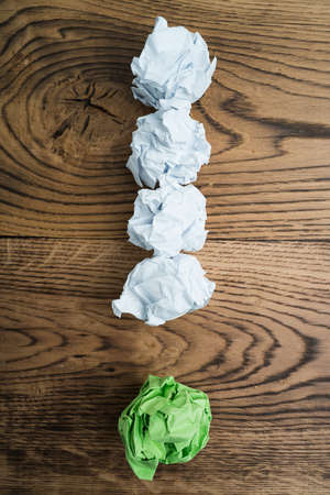 capability: crumpled paper symbolizing different solutions forming an exclamation-mark