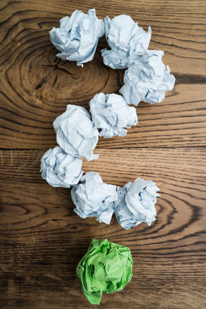 crumpled paper symbolizing different solutions forming a question-mark Stock Photo