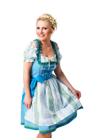 beautiful woman in a traditional bavarian dirndl isolated on white Stock Photo