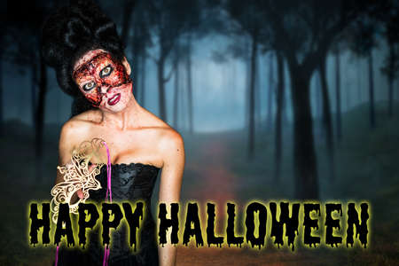 creepy fashion zombie with Happy Halloween message in front of creepy forest scene