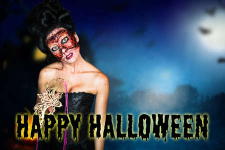 creepy fashion zombie with Happy Halloween message in front of halloween scene