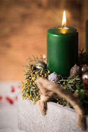 modern Advent arrangement with lit candles on wooden table Stock Photo