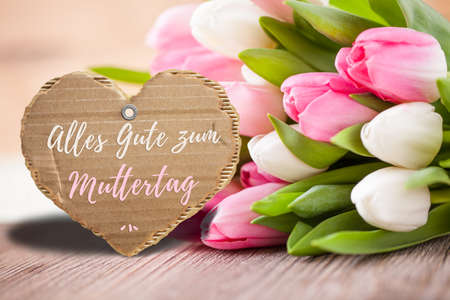 tulips with message saying Happy Mothers Day in German