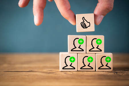 team accepts an proposal symbolized by icons on stacked cubes Stock Photo