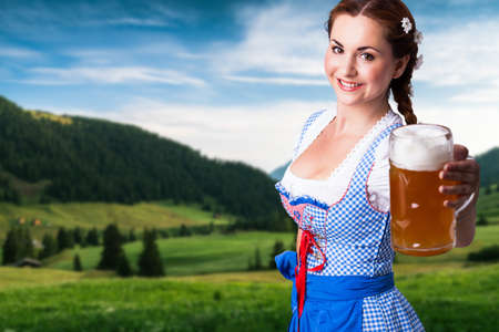 beautiful woman in a traditional bavarian dirndl with a beer Stok Fotoğraf