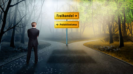 Businessman standing at a crossroad having to decide between