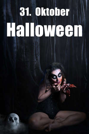 creepy woman with a bloody face in her hands and the message 31. October Halloween (Date in German) Stock Photo