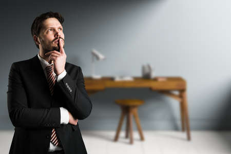 businessman is thinking intensely in front of an office scene