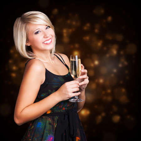 attractive woman in evening wear in front of lights background Banco de Imagens