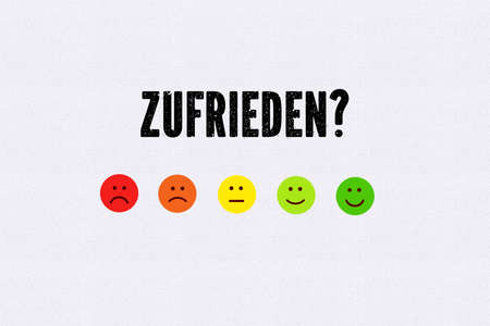 emoticons and message satisfied? in German on white background Zdjęcie Seryjne