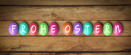 Easter Eggs on wooden background with message
